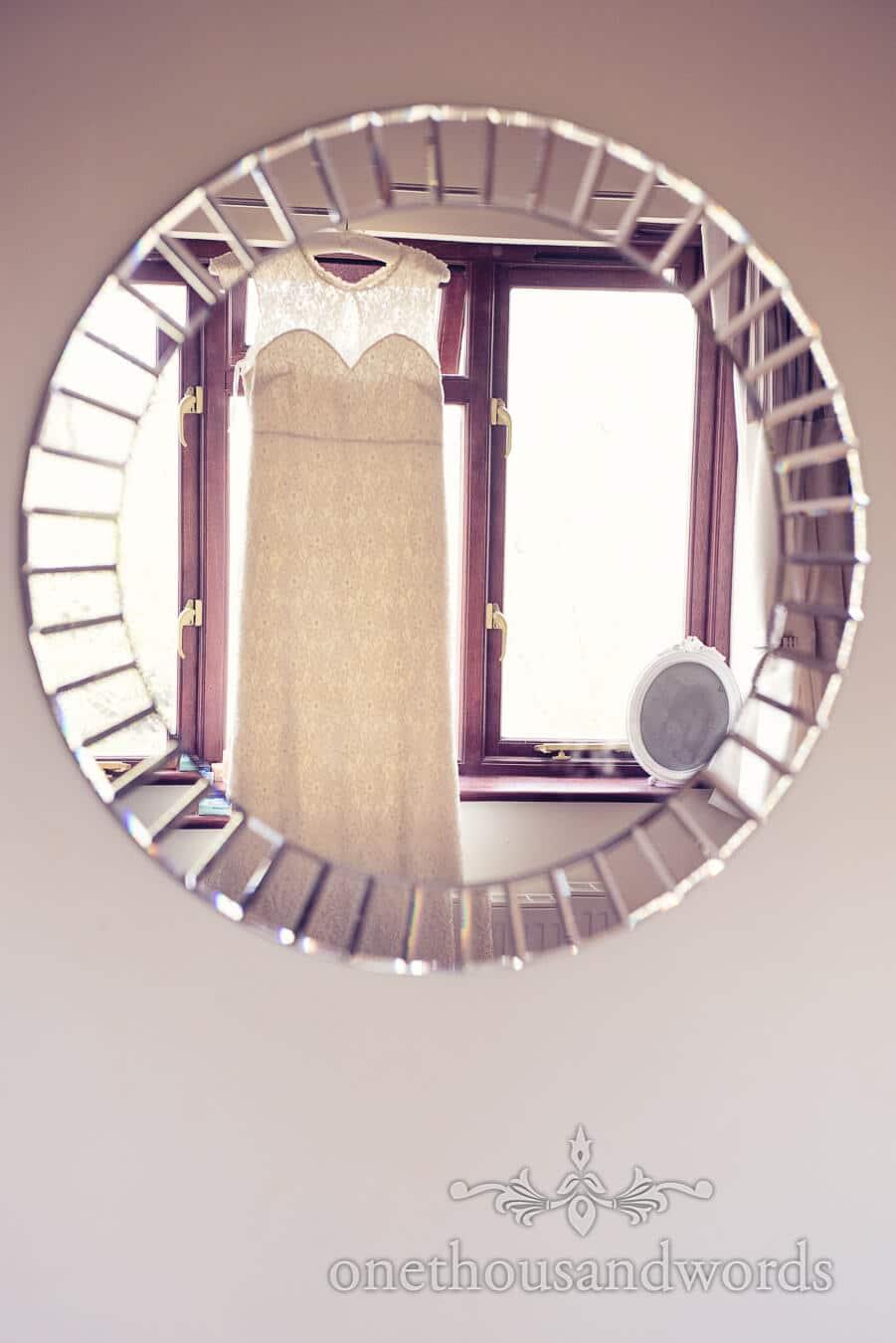 Dress in mirror on morning of Purbeck Golf Club Wedding
