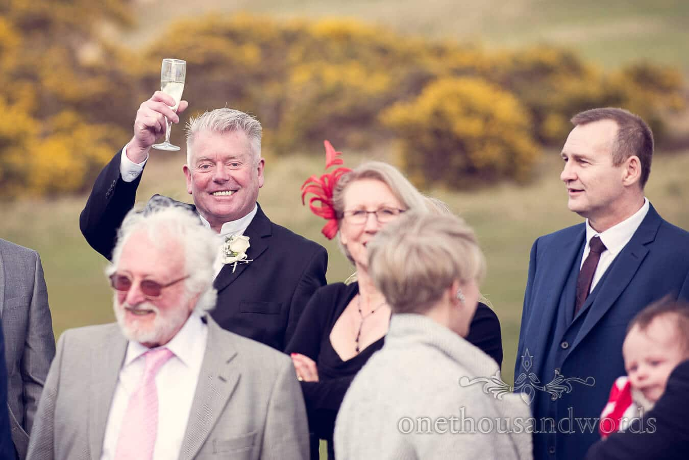 Father of the groom raises glass at Purbeck Golf Club Wedding