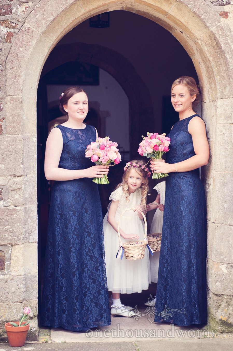 Flower girls and bridesmaids await the bride from wedding at Sopley Mill