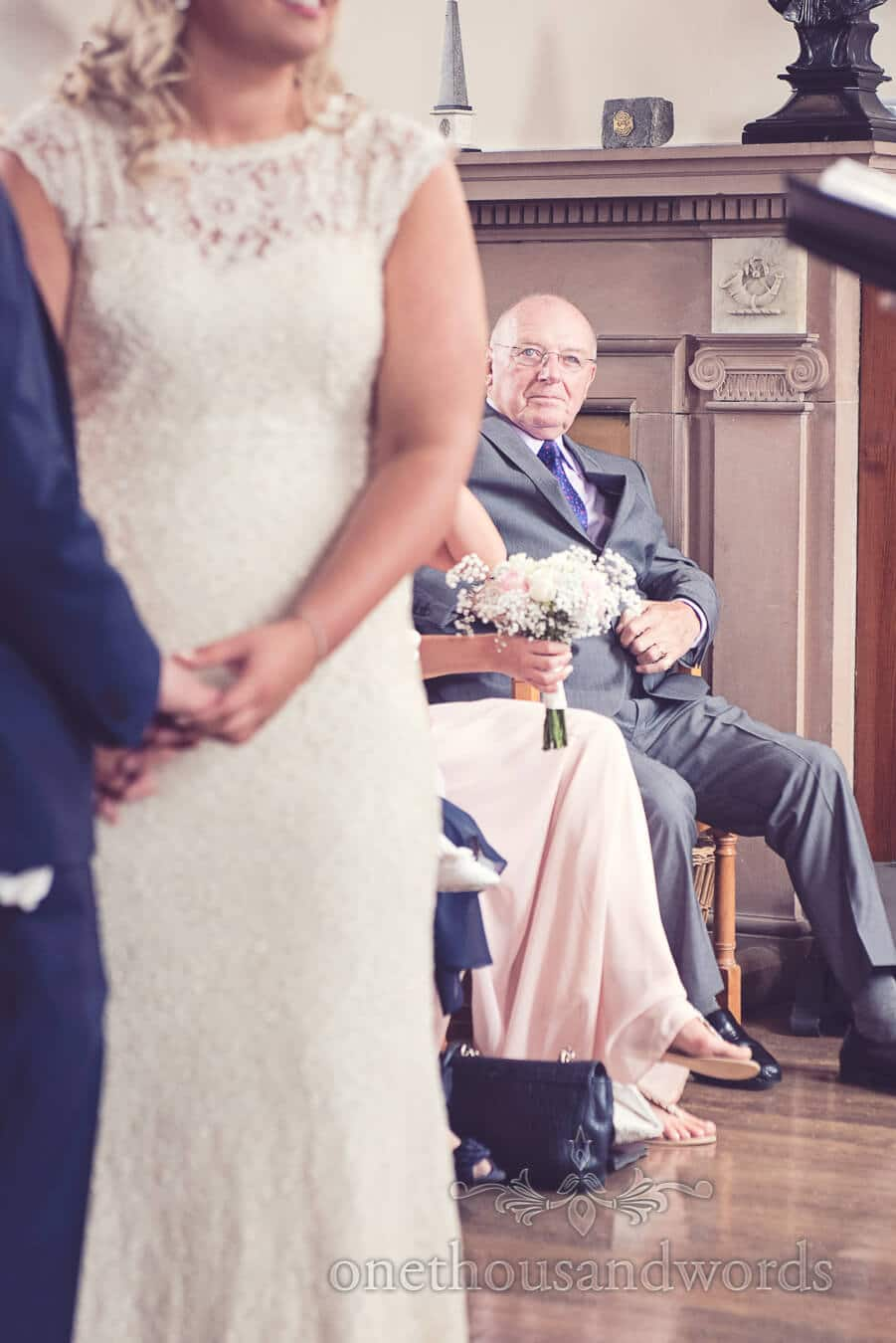 Grandfather looks on at Purbeck Golf Club Wedding