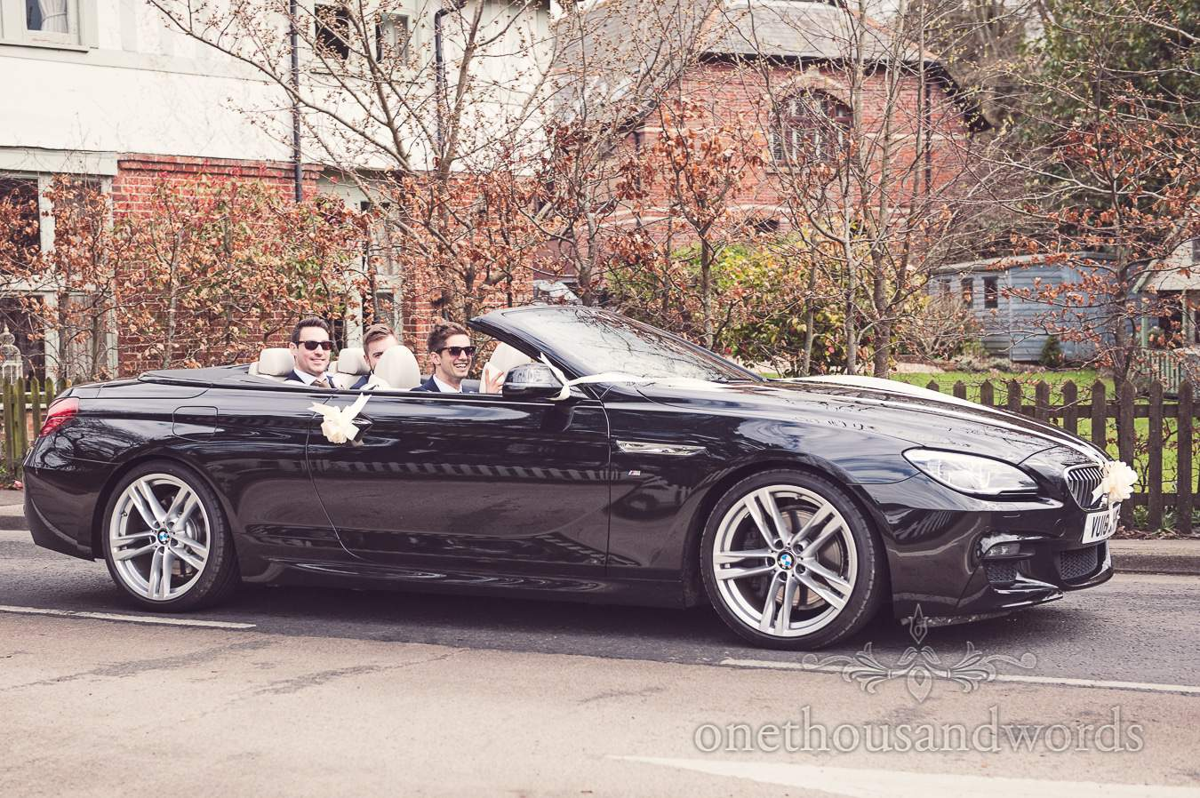 Groom and best men in wedding car before wedding at Sopley Mill