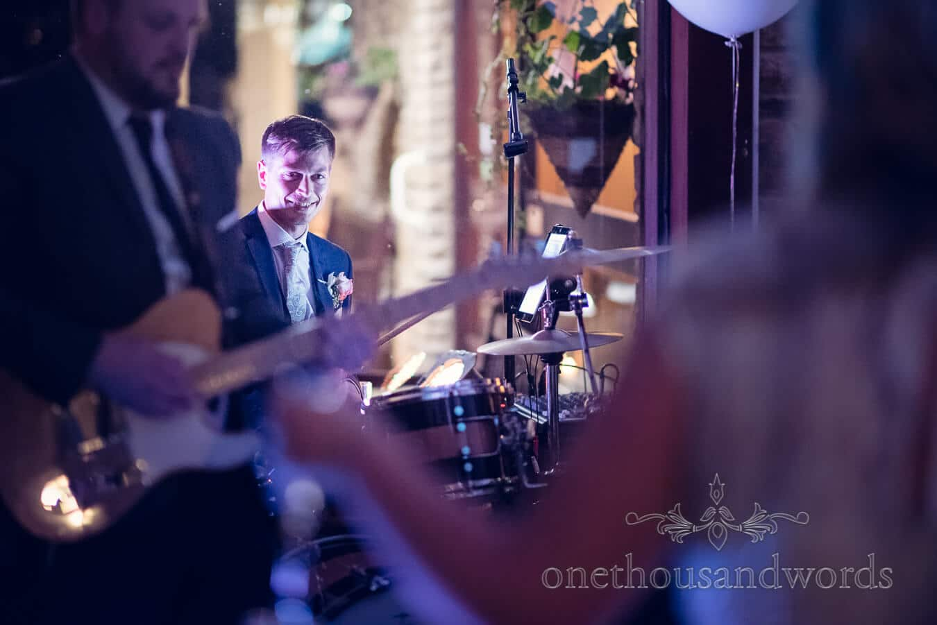 Groom plays the drums at Purbeck Golf Club Wedding