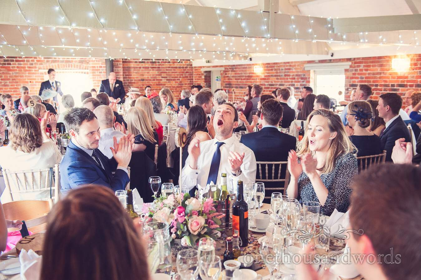 Guest reaction during speeches from wedding at Sopley Mill