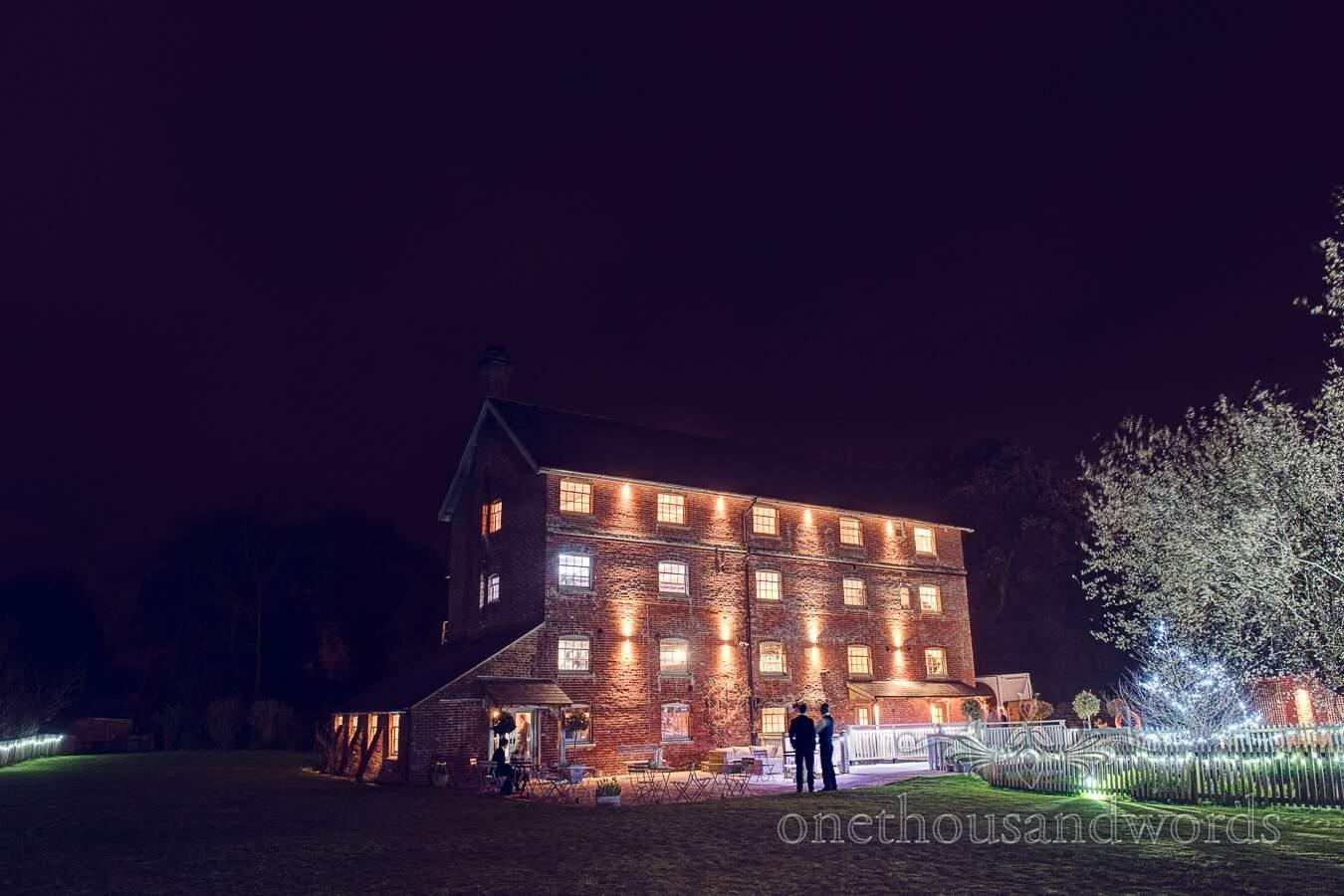 Mill exterior at night from wedding at Sopley Mill
