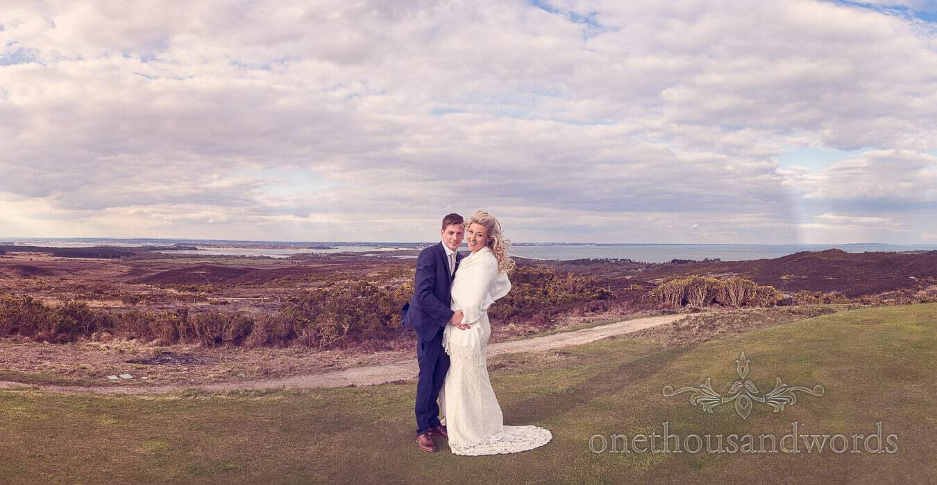 Newlyweds in front of Poole harbour at Purbeck Golf Club Wedding