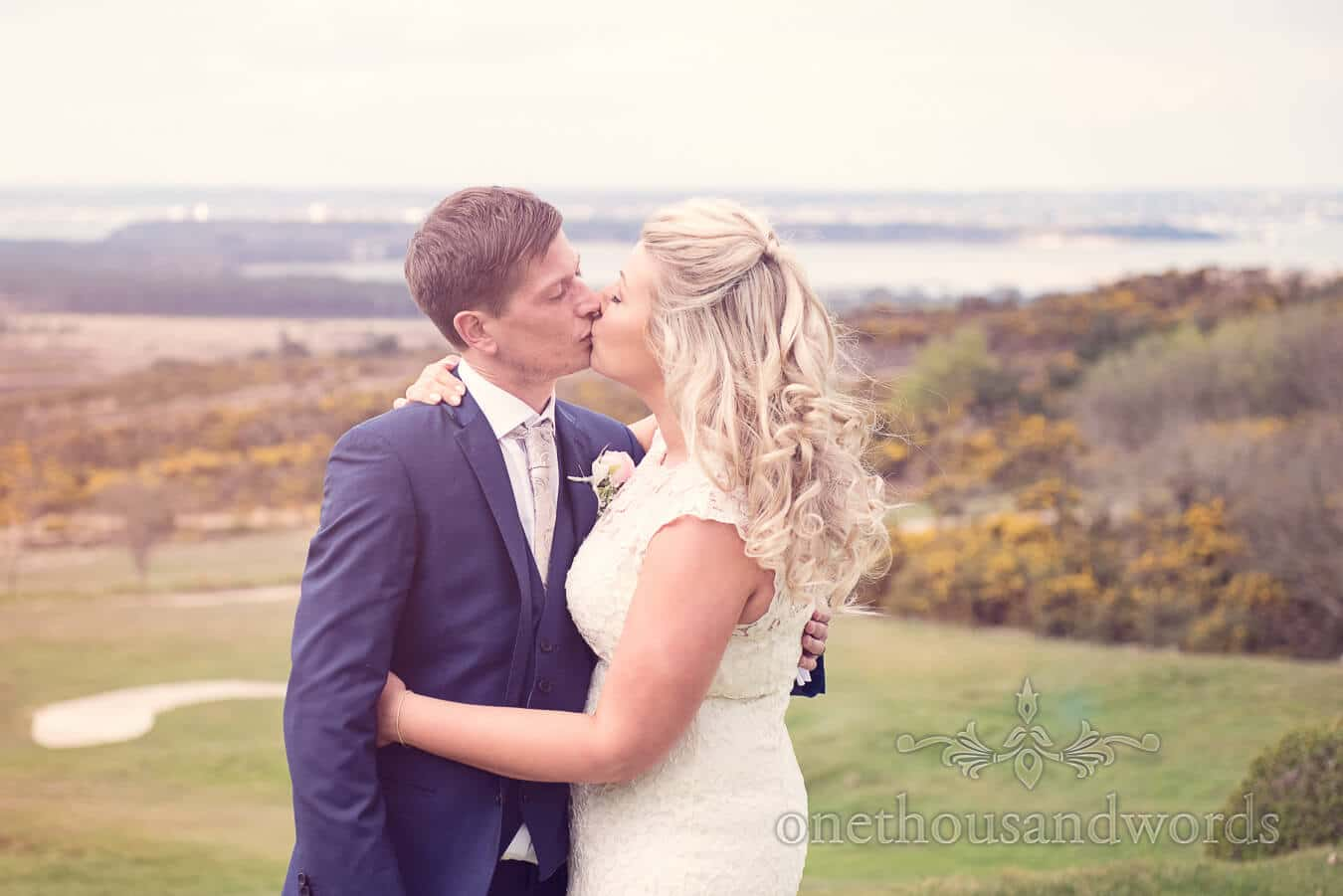 Newlyweds kiss at Purbeck Golf Club Wedding