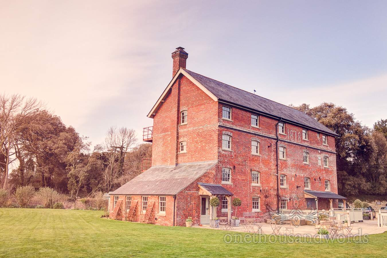 The mill from garden during wedding at Sopley Mill