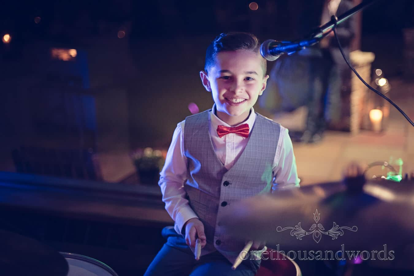 Young guest on drums at Purbeck Golf Club Wedding