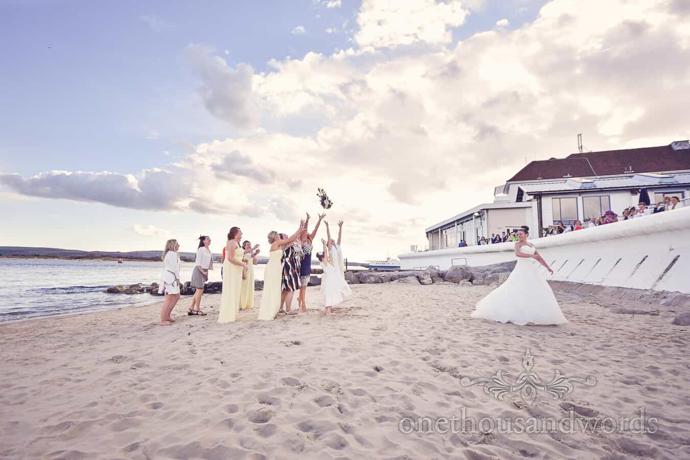 Bouquet toss on the beach from Haven hotel wedding