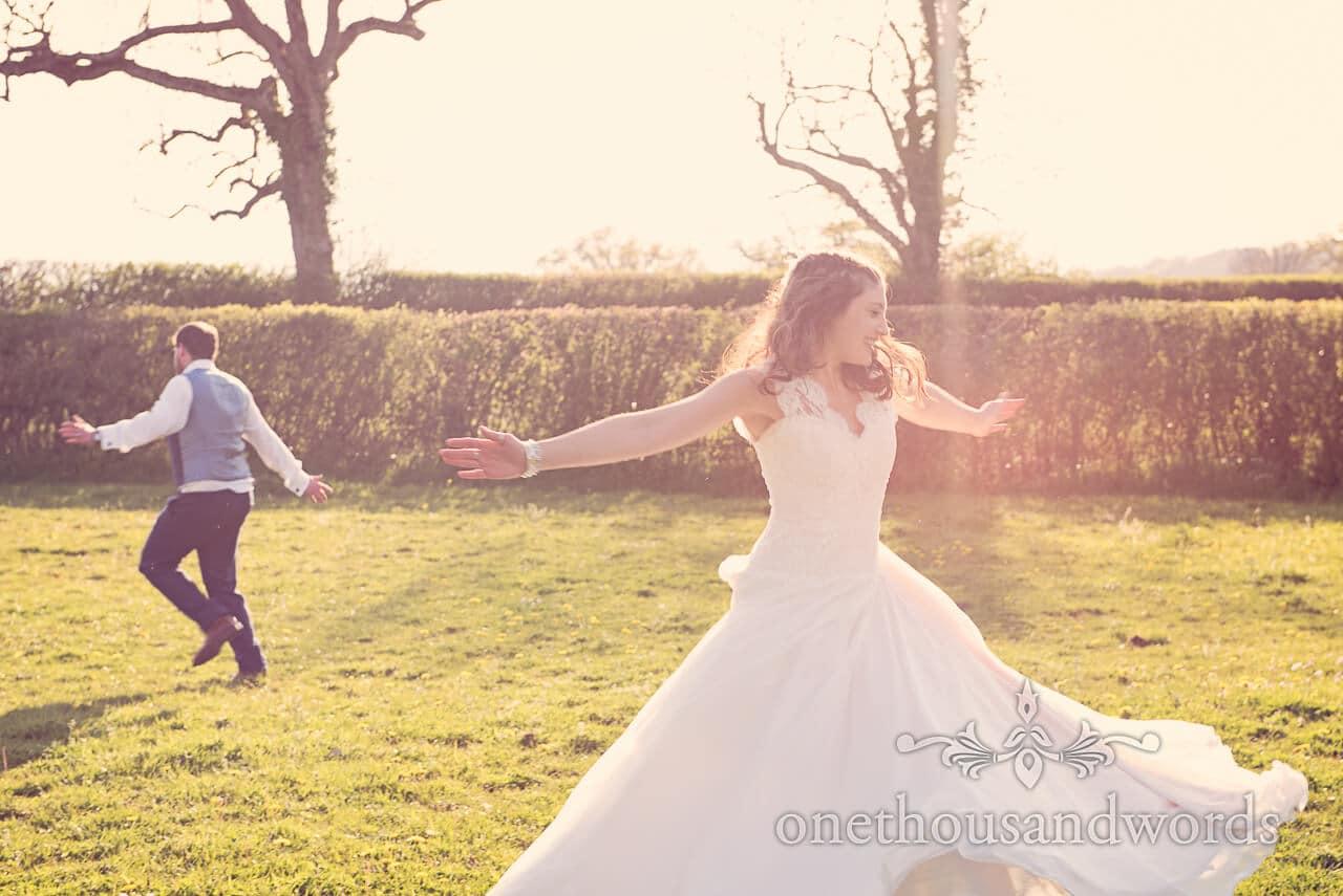 Bride and groom dance in the garden at Barn Wedding