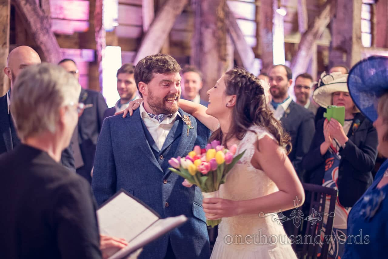 Bride and groom during ceremony at Barn Wedding