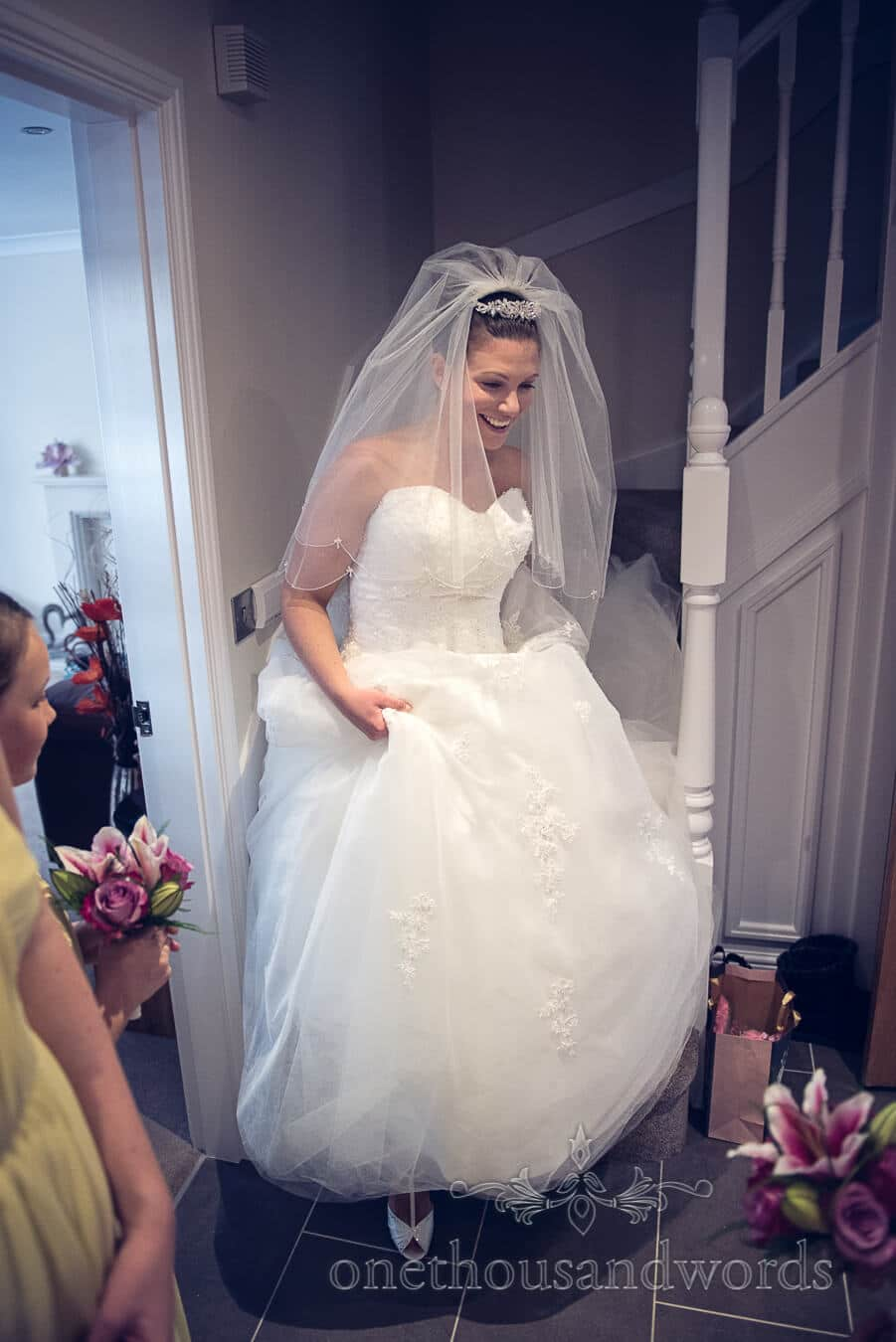 Bride ascends stairs before Haven hotel wedding