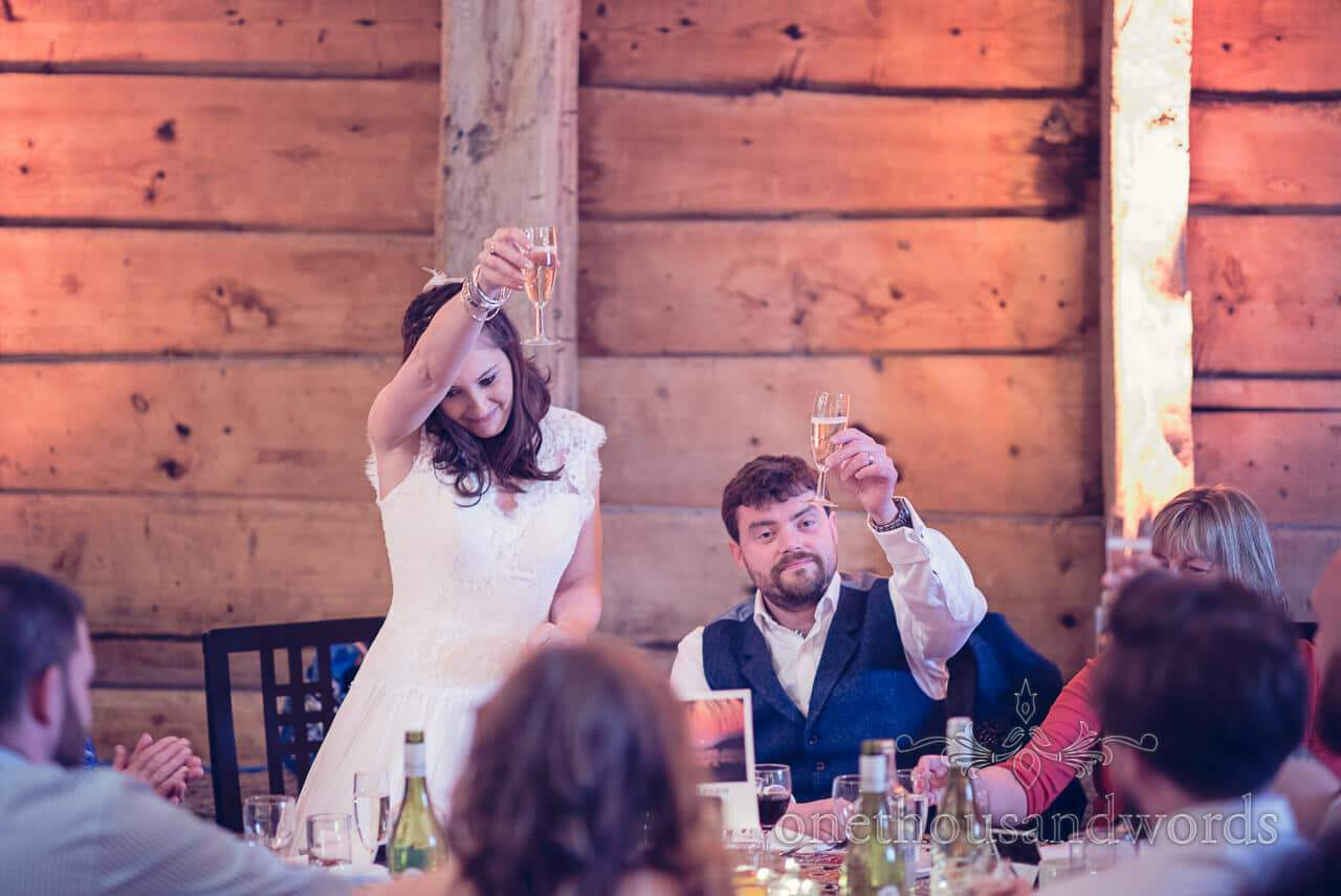 Bride calls for a toast at Barn Wedding