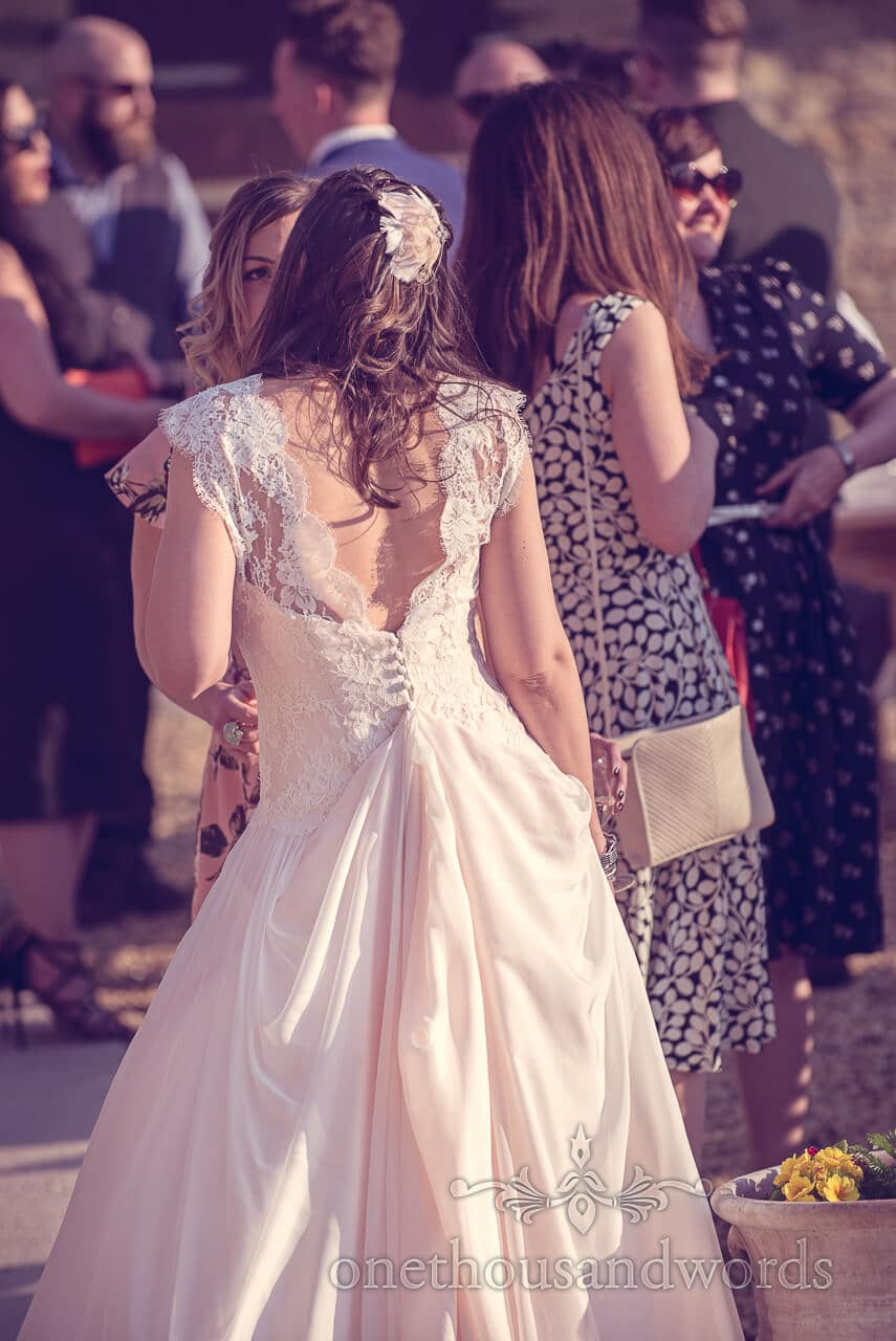Bride chats to guest at Barn Wedding