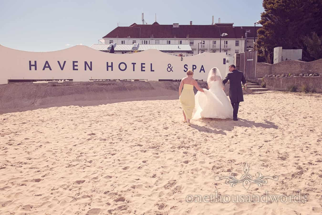 Bride ,groom and bridesmaid at Haven hotel wedding