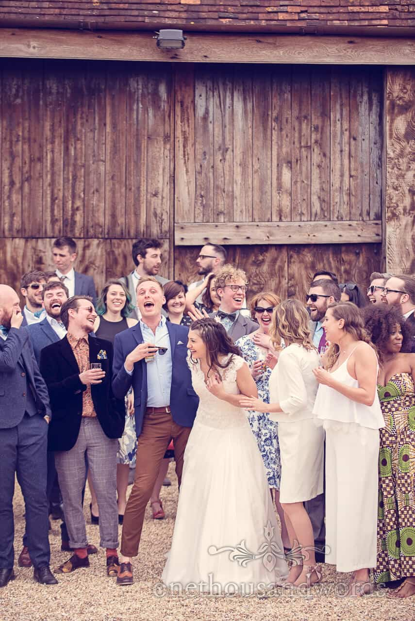 Bride, groom and guests during group photos at Barn Wedding
