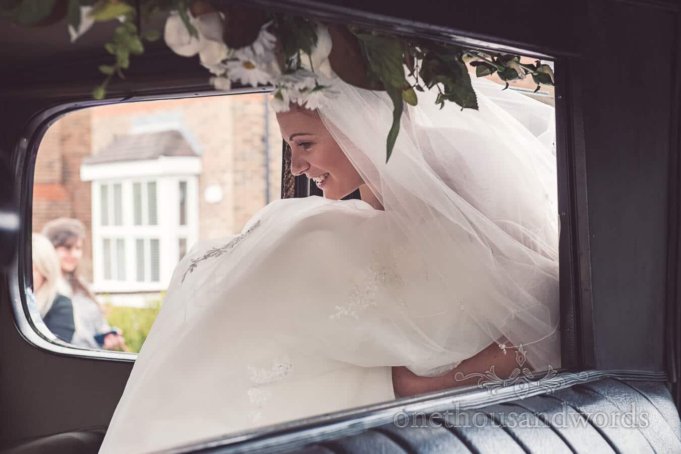 Bride in wedding car at Haven hotel wedding