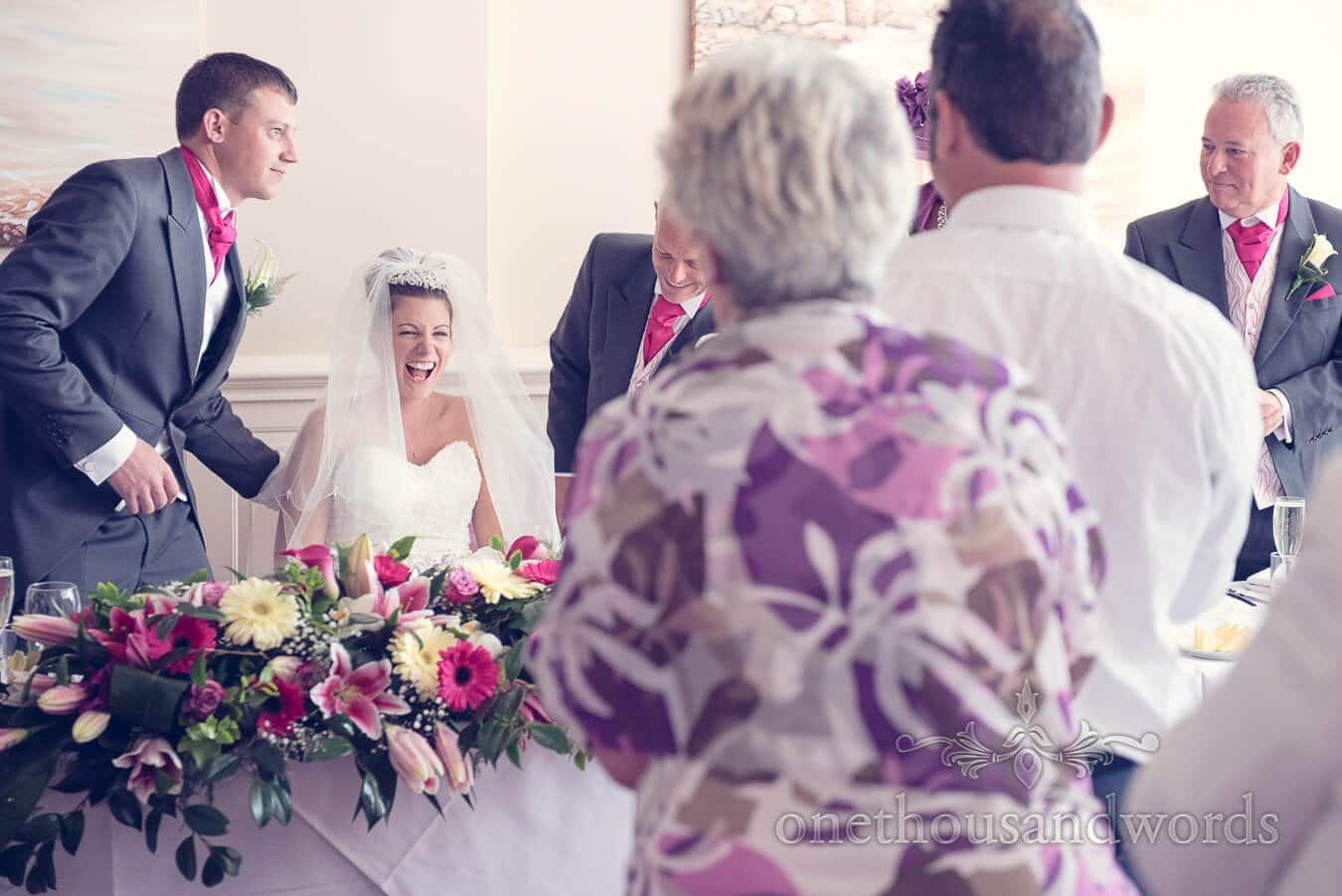 Bride laughs during Haven hotel wedding