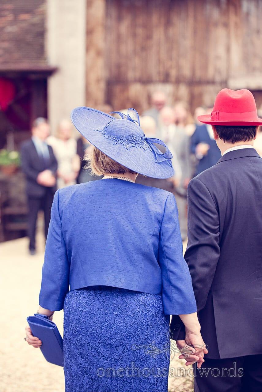 Brides parents in hats at Barn Wedding Photographs