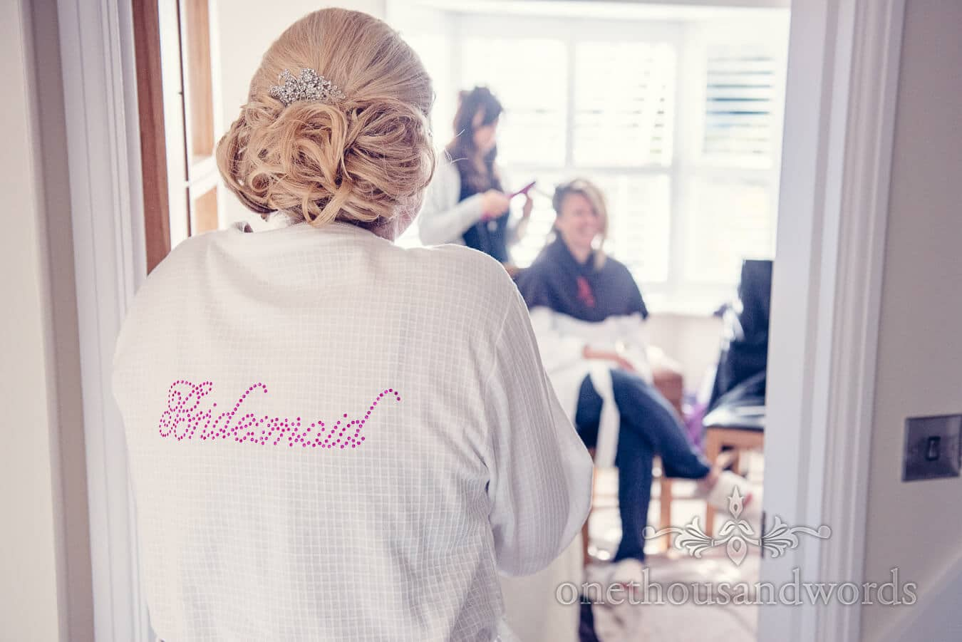 Bridesmaid in detailed dressing gown before Haven hotel wedding
