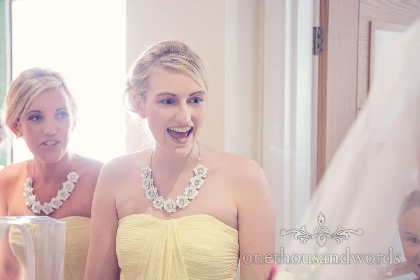Bridesmaids reaction to seeign bride in weddign dress