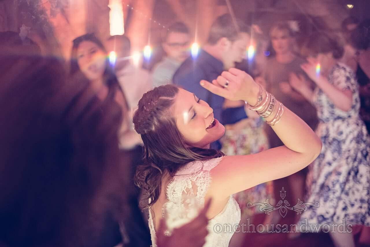 Dancing bride at Barn Wedding