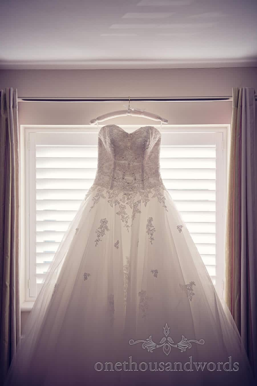 Dress lit in window before Haven hotel wedding