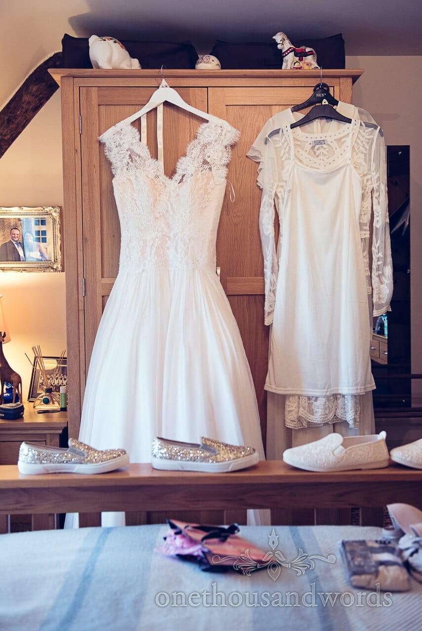 Dresses hand on wardrobe at Barn Wedding