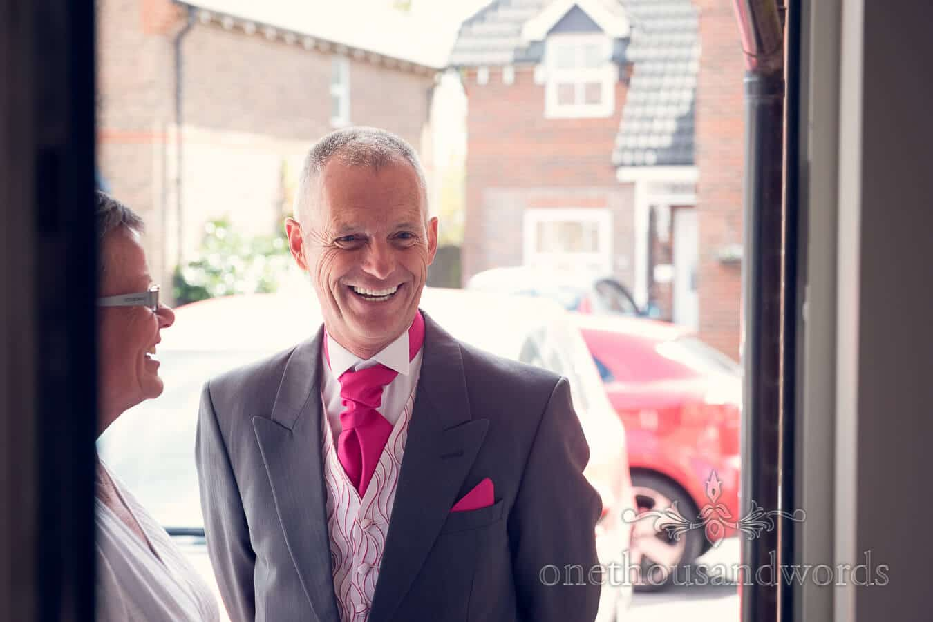 Father of the bride in Pink tie and handkercheif