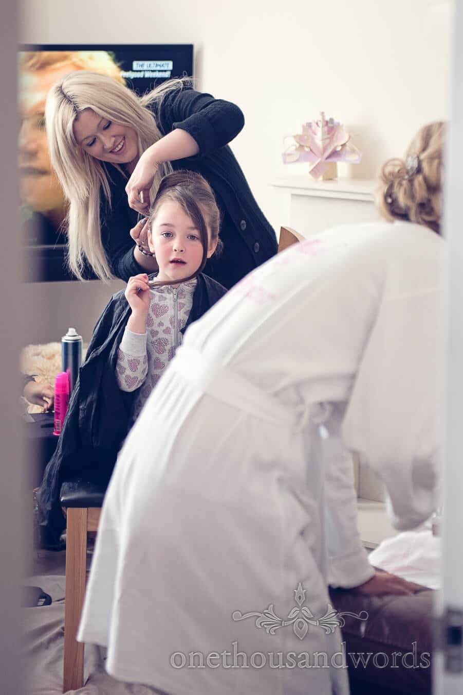 Flower girl has hair done before Haven hotel wedding