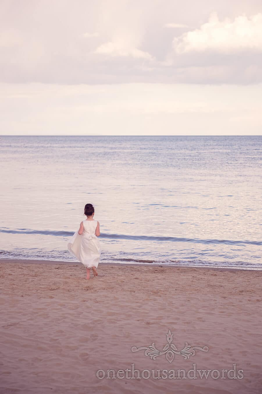 Flower girl on beach from Haven hotel wedding