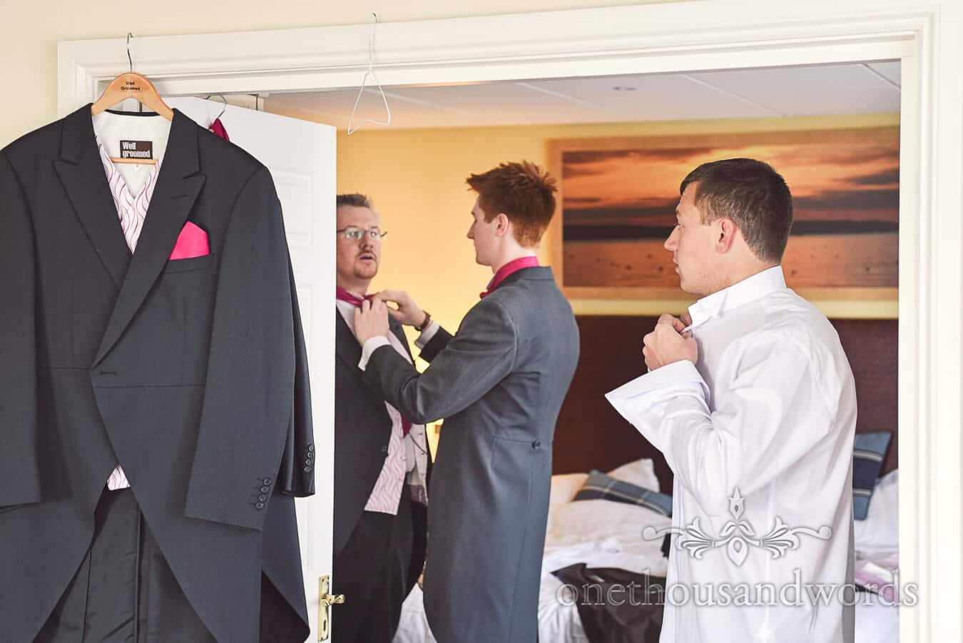 Groom and groomsmen prepare before Haven hotel wedding