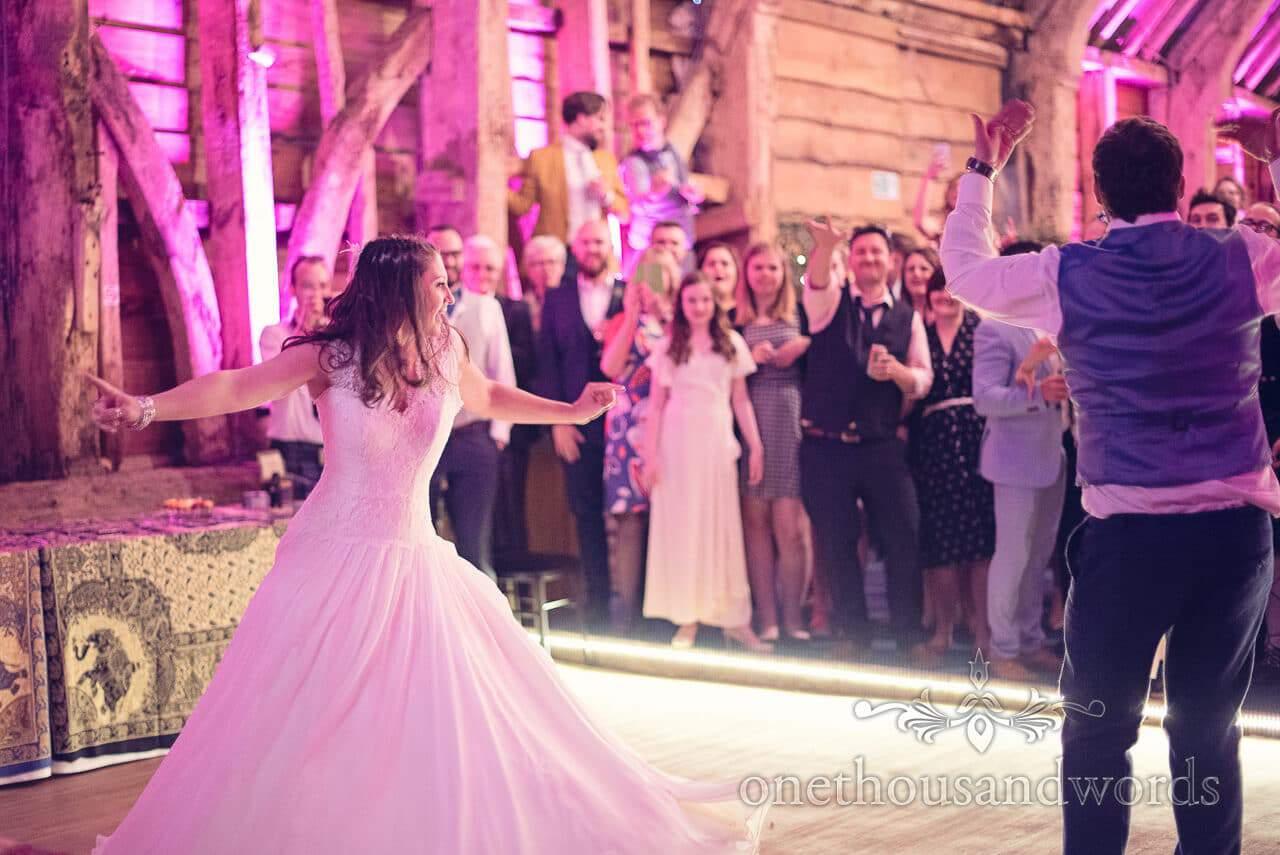 Groom beckons guests onto dance floor at Barn Wedding
