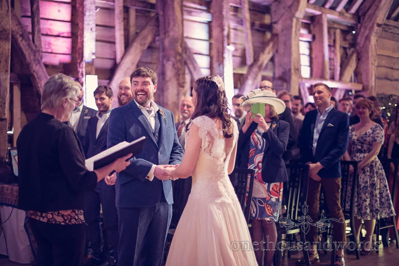 Groom smiles during wedding ceremony