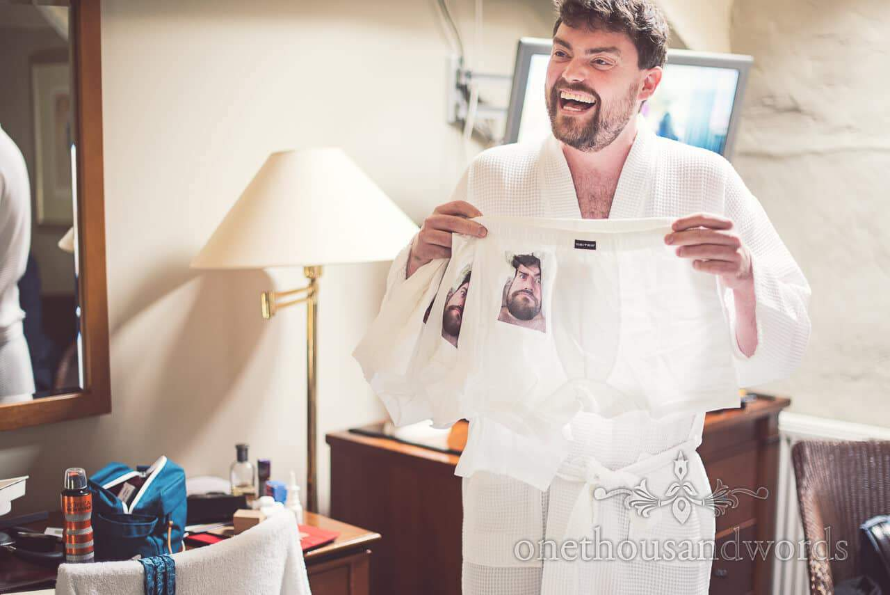 Groom with custom boxer shorts for his groomsmen
