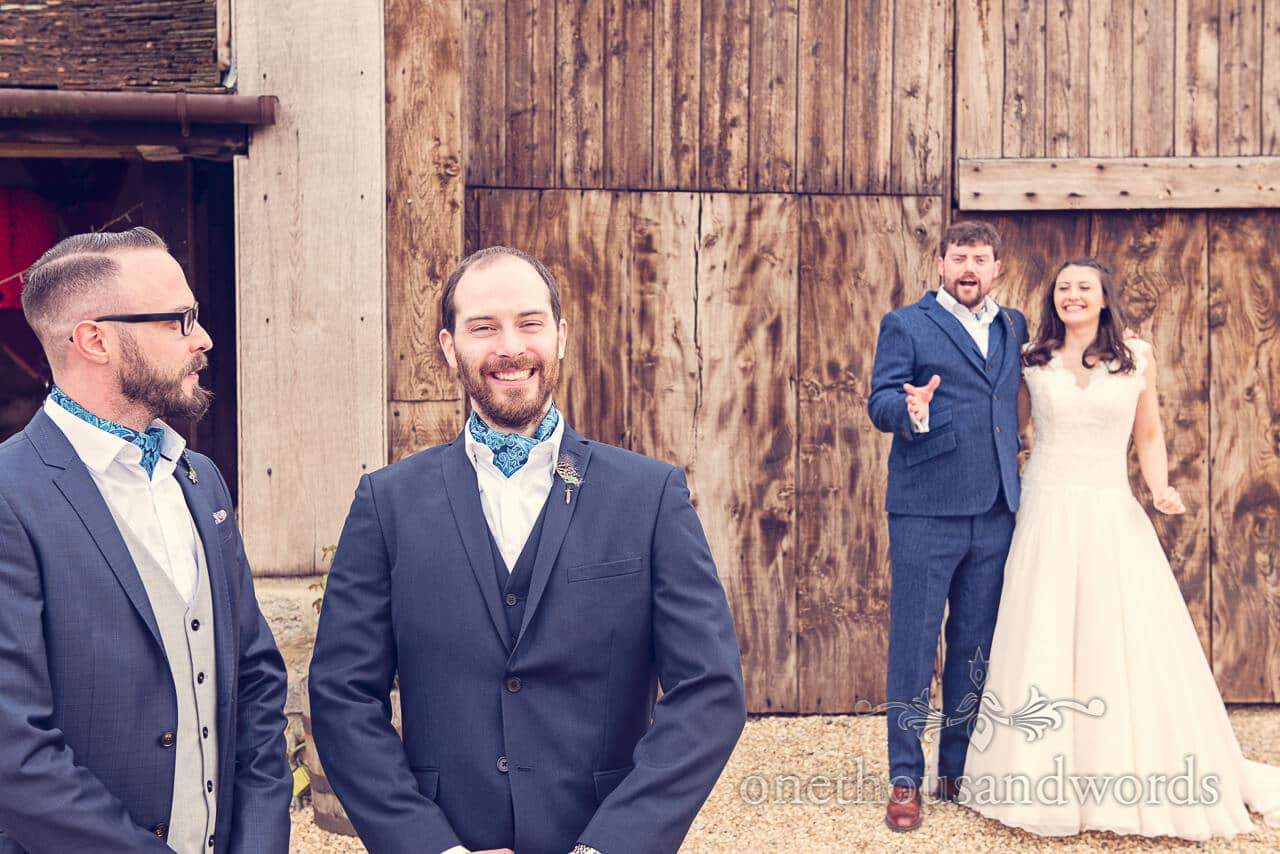 Groomsmen, bride and groom at Barn Wedding