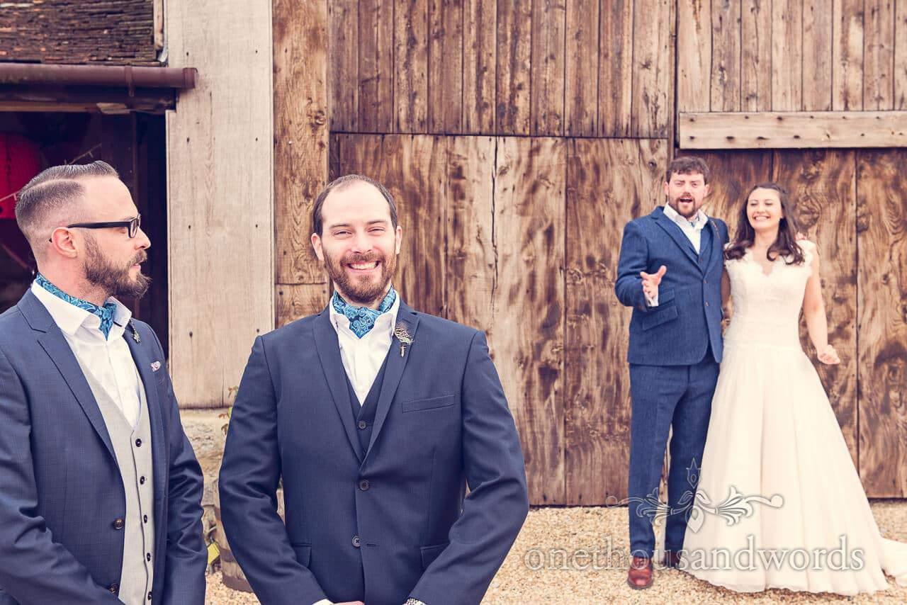 Groomsmen, bride and groom at Barn Wedding