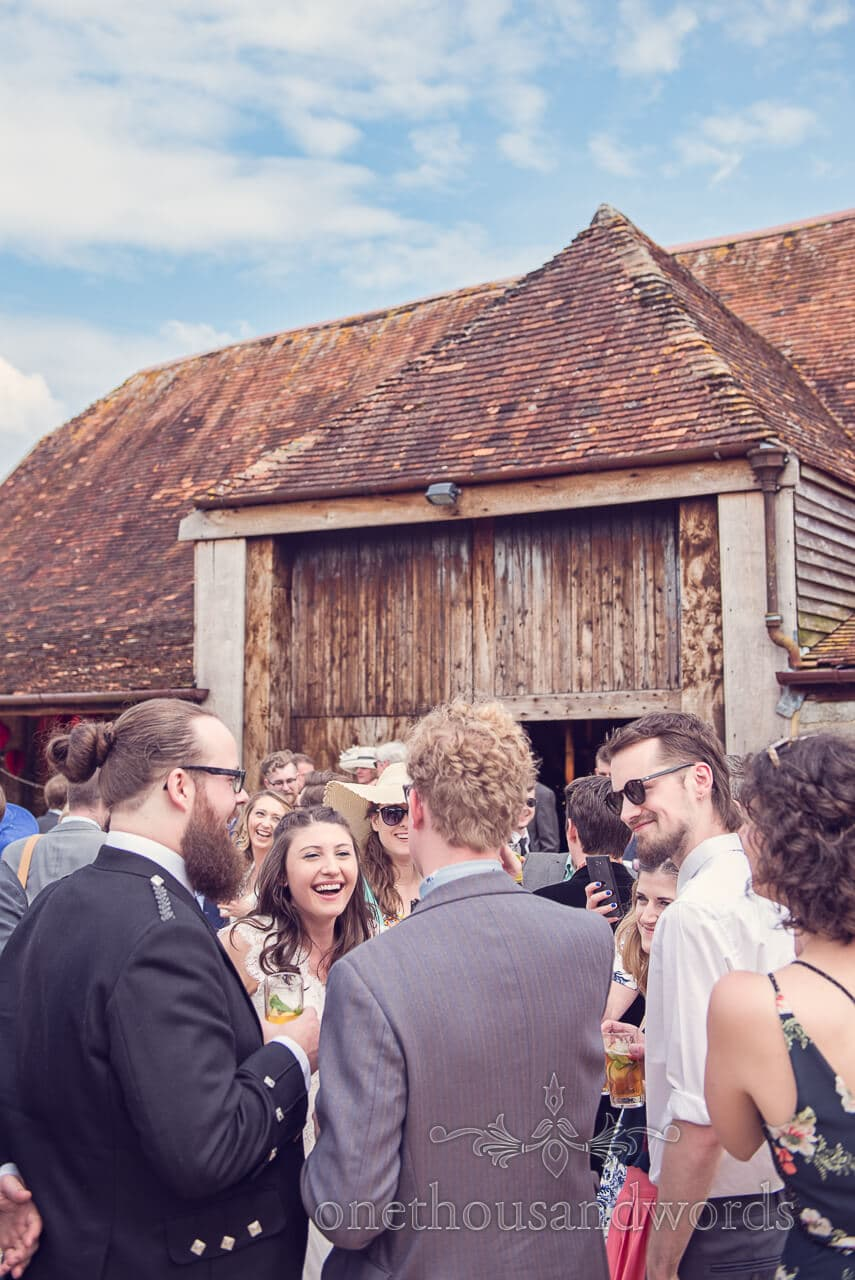 Guests and bride gather outside at Barn Wedding