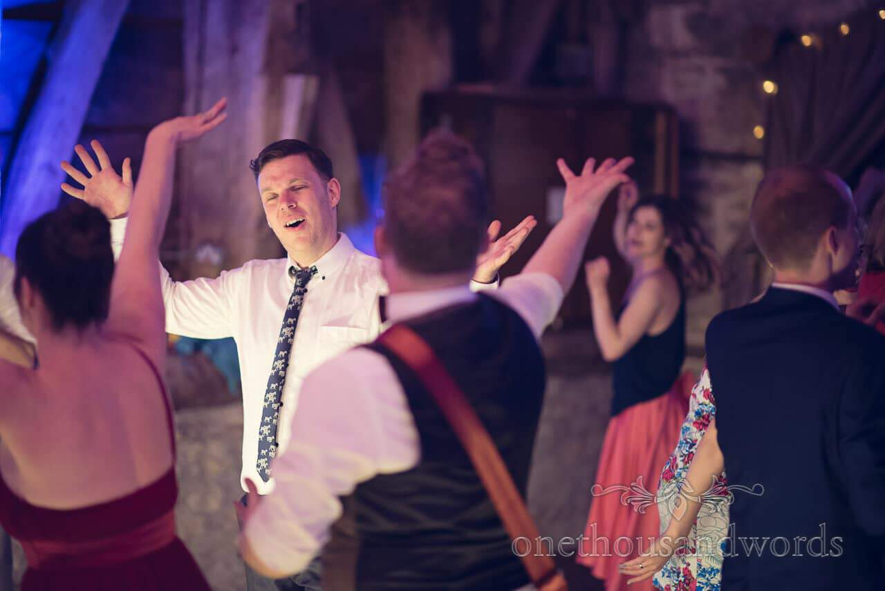 Hands in the air on dance floor at Barn Wedding