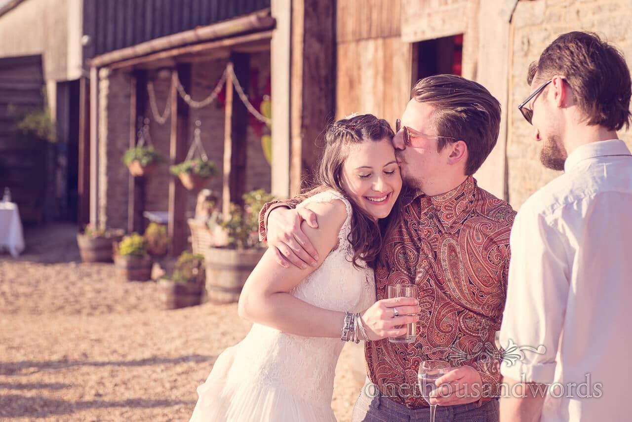 Hug and a kiss at Barn Wedding