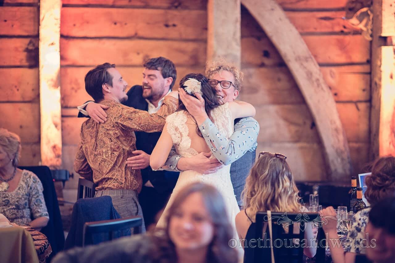 Hugs at Barn Wedding