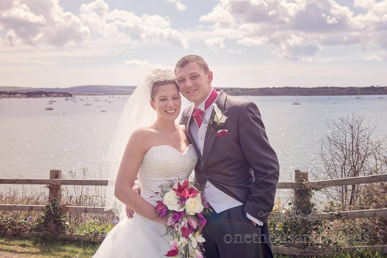 Newlyweds at Poole harbour from Haven hotel wedding