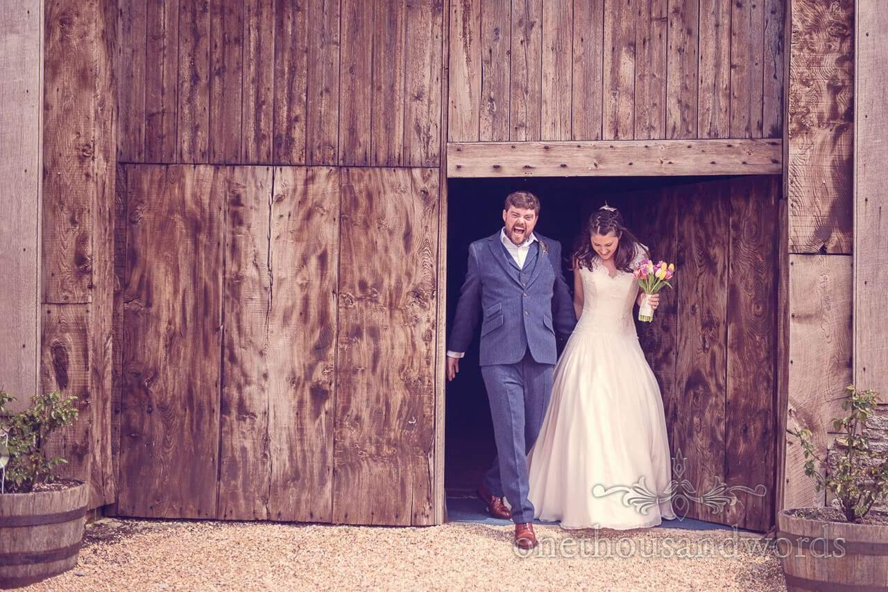 Newlyweds exit at Barn Wedding