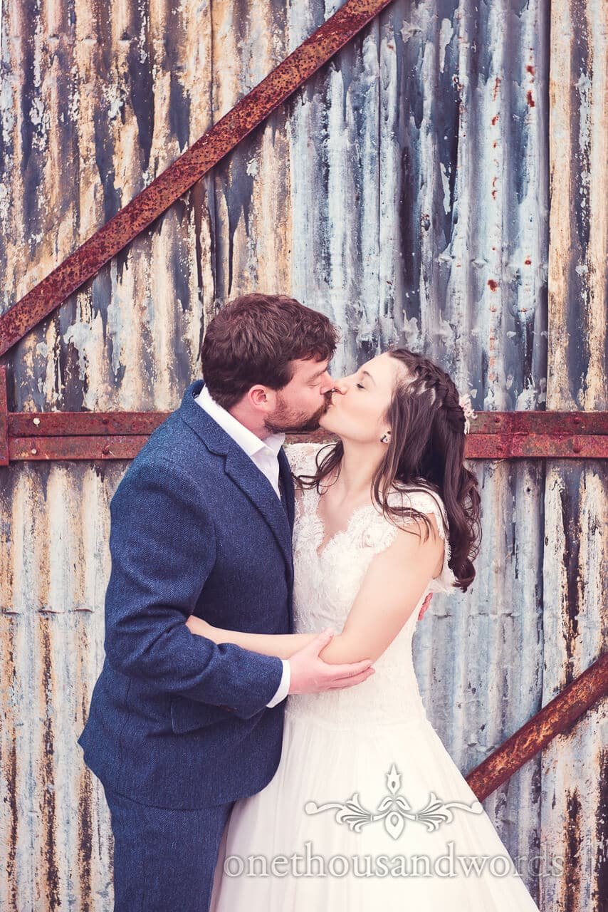 Newlyweds kiss at Barn Wedding