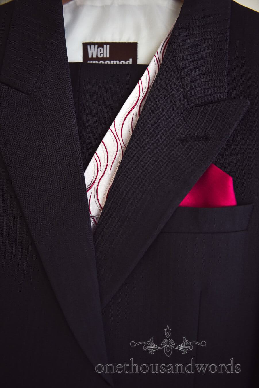 Well Groomed Wedding suit with pink detailing