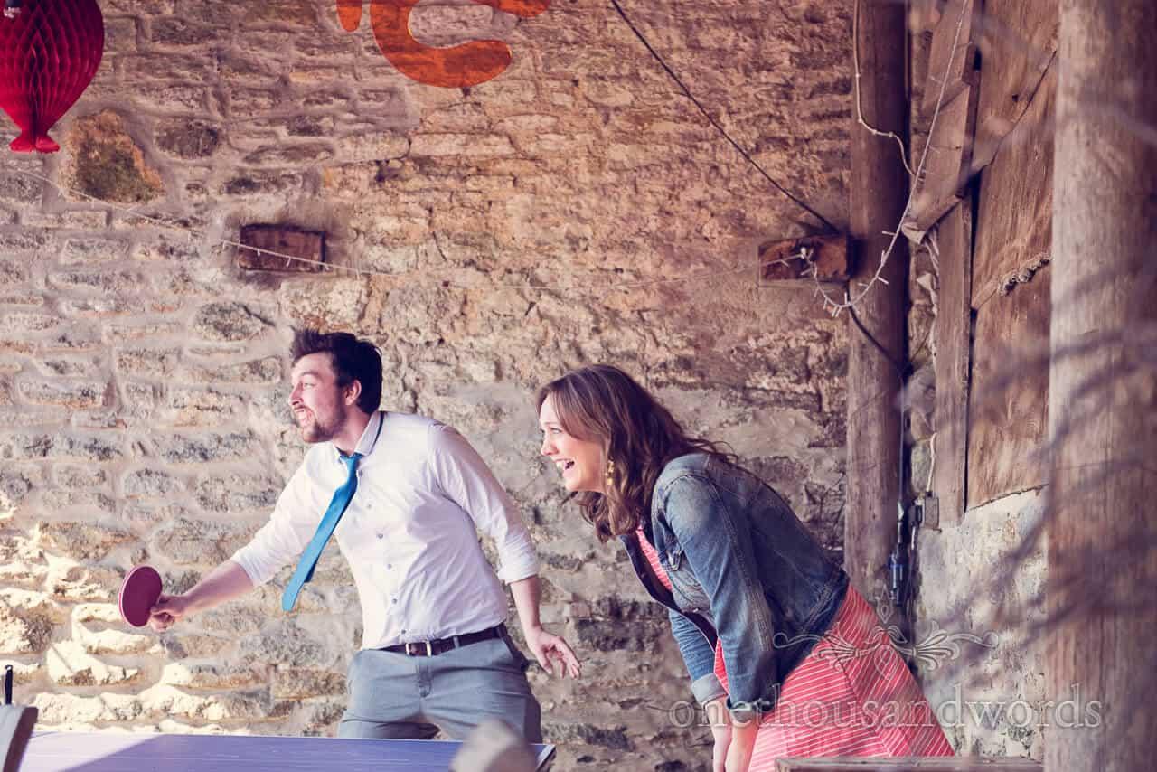 Table tennis playing guests at Barn Wedding