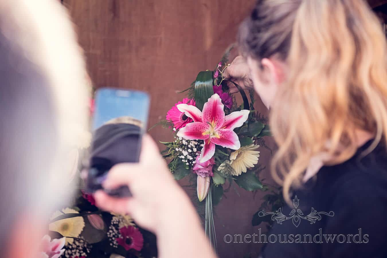 Taking pictures of wedding flowers