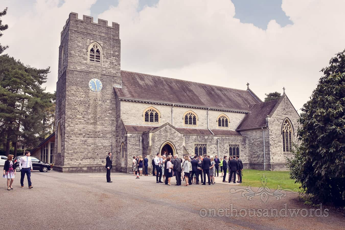 Wedding guests gather outside church