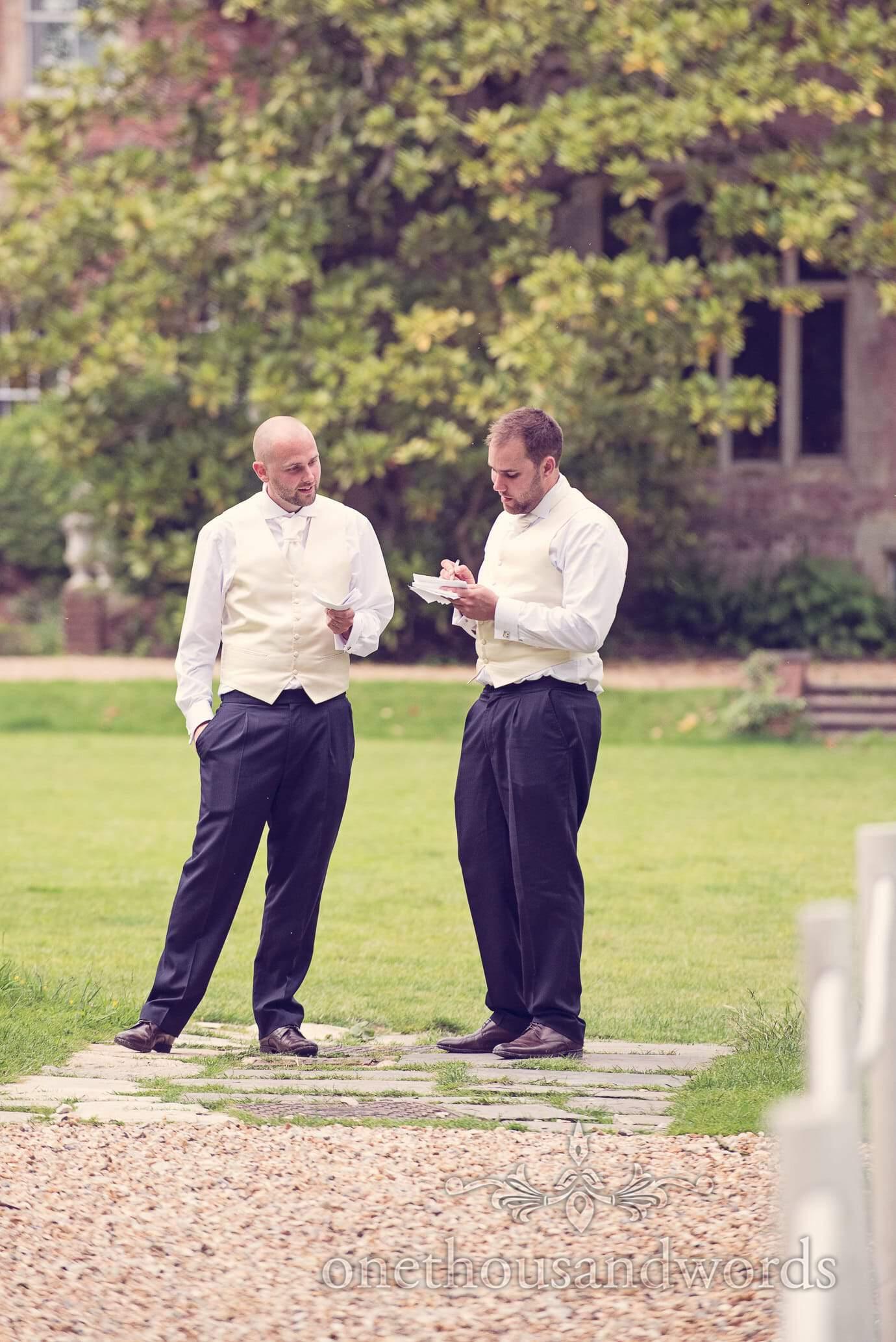 Best men practice their speeches in gardens at Deans Court Wedding