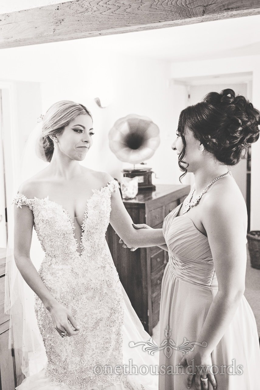 Black and White Wedding Photograph of Bride and bridesmaid on wedding morning